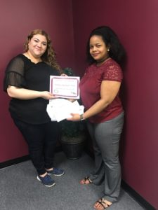 Our Champion of the Month for June is Damarys Rodriguez-Torres. Pictured with Damarys is Merely, Champion Personnel Recruiter. Congratulations Damarys!